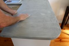 STYLE CURATOR give an outdated kitchen a makeover with a DIY concrete countertop. Check out before