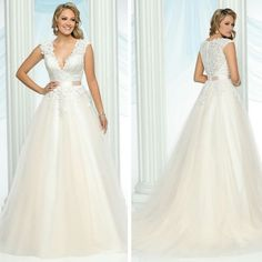 This #Davincibridal #ballgown features lace on the bodice