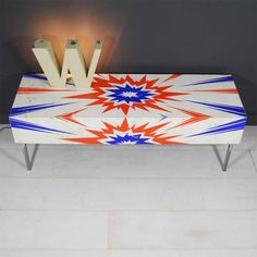 Wham! Table; long thin coffee table with open ended storage, made from the sides of a 70's Italian pinball machine with 15mm tubular raw steel base/legs. #tilt #tiltoriginals #upcycled #upcycling #vintage #coffeetable #pinball #comics #1970s #storage
