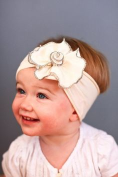 Snugars (etsy shop)--gorgeous headbands/hats for little girls    Ah! This is too cute! I think I know a baby who might need something like this...