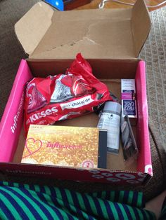 My J'Adore VoxBox which includes red rose simply indulgent teas, Hershey's kisses, John Frieda frizz ease 3 day straight flat iron spray, KISS looks so natural lashes, and boots botanics shine away ionic clay mask