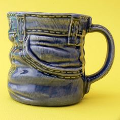 Jolly Polly Pickins (flikr)    Make a mug/jug/vase which appears to be created out of a material other than clay.
