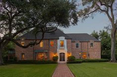 1412 North Boulevard Houston, TX 77006: Photo Three story French style brick home located in the coveted Broadacres Historic District, is one of 26 large lots originally developed in the 1920's and enviably situated within close proximity to Rice University and the Museum District.