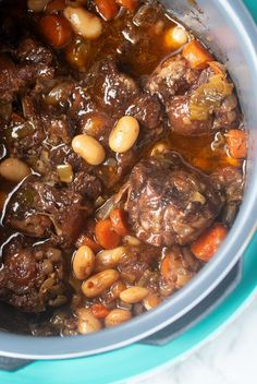 This Jamaican Oxtail recipe is the perfect Caribbean stew for dinner. Delicious and tender oxtail and butter beans that is cooked to perfection. Make it in the Instant Pot or any electric Pressure Cooker. Slow cooker instructions also included. Oxtail Recipes Crockpot, Beef Recipes, Cooking Recipes, Family Recipes, Recipies, Carribean Food, Caribbean Recipes, Jamaican Oxtail Stew, Oxtail Meat