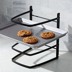 A must-have for prolific bakers, folding cooling rack opens up to four racks, generously sized to hold four large baking sheets and up to 10 pounds of baked goods per arm. Iron with powdercoat finish Holds up to 10 pounds per arm Hand wash Made in China Design My Kitchen, Kitchen Decor, Kitchen Ideas, Beautiful Kitchens, Cool Kitchens, Bakers Kitchen, Kitchen Tools, Dark Home Decor, Bakers Rack