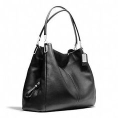 A designer conceal carry purse! Coach :: MADISON PHOEBE SHOULDER BAG The cool thing about it is there is a middle zipper pocket that is huge and hidden but can be accessed without opening the purse at the top. So.. It's perfect for conceal carry. Find our speedloader now! http://www.amazon.com/shops/raeind