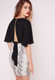 Look effortlessly irresistible in this floaty crop top. With a V neckline, tie back and flute sleeves, you'll be on top of your style game. Style tip: team with your fave snakeskin skirt (snakeskin is totally slithering its way back into ou...