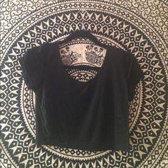 Black crop top Never worn. It is Brandy inspired Brandy Melville Tops Crop Tops