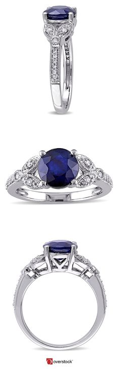 This vintage-style engagement ring has a gorgeous, blue diffused sapphire at the center. A unique split shank design in the shape of leaves gives this piece a sense of delicacy. Crafted in white gold, this ring features a prong-set diffused sapphire with 16 pave-set and two bezel-set diamonds resting on its band.