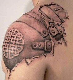 Shoulder cap tattoo of peeled back skin with leather Celtic armor underneath. This is seriously cool!
