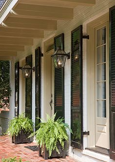 I love the southern, Acadian vibe. Floor to ceiling windows, black shutters, brick porch, ok everything! Just have to be sure those are real gas lanterns New Orleans Decor, New Orleans Homes, Brick Porch, Front Porch, Porch Windows, Gas Lanterns, Porch Lanterns, Black Shutters, House Shutters