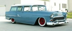 55 Chevy Wagon, two tone blue with white roof, lowered,side exhaust, red rims with wide white walls