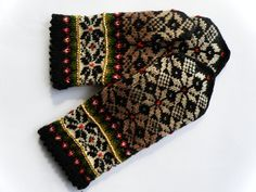 High quality hand knitted warm wool mittens , gloves patterned Brown, white, black. $50.00, via Etsy.