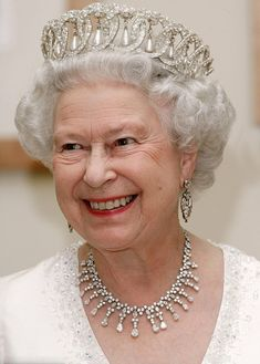 Queen Elizabeth II in a tiara 'Vladimir' with diamonds and pearls.  She is also  wearing a fringe necklace with pear-shaped diamonds and the girandole earrings.
