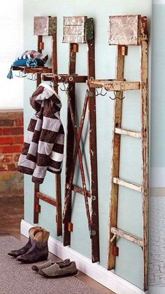 Old Ladders used as organizers for entry, lovely look and clever with the added hooks