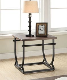 """Debbie collection cherry finish wood top and black metal frame end table.  End table measures 24"""" x 24"""" x 24"""" H.  Some assembly required."""