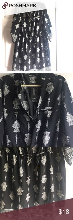 NWT light fun dress! Bought this dress. I never wore it. Very flattering. Fun for summer or winter.  The print reminds me of a hamsa. Smoke free home. Indulge Dresses