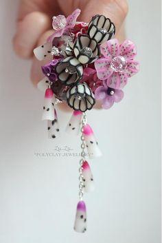 """.Zu.Zu. / Urban flower. It says """"polyclay jewelry"""""""