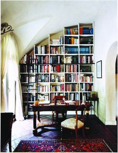 GorgeousDesign- Bookcases to match graceful curving ceiling.