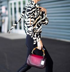 Zebra print paired with black fitted pants. // #StreetStyle