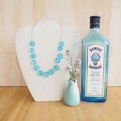 Items similar to Blue recycled glass bead necklace. Beads made from a gin bottle! Elegant, colourful necklace, adjustable, and makes a great gift. on Etsy Sapphire Gin, Bombay Sapphire, Cutting Wine Bottles, Bottle Cutting, Glass Jewelry, Glass Beads, Jewellery, Gin Bottles, Glass Bottles