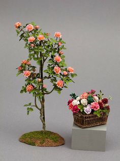 Dollhouse miniature small rose tree and basket of roses by Carol Wagner