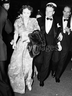 Contrary to caption, this isn't Billie.  Mr  Mrs James Cagney, May 29, 1942 - portrait of American actor James Cagney (1899 - 1986) and his wife, Frances Bill, standing in front of a crowd in a hallway during a formal event.
