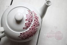 i dont really do just white. so while ive been studying for the last couple of days every study break i added some dots to the tea pot. its actually really easy. just some porcelain paint, a tooth pick and some patience