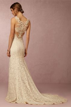 Absolutely stunning lace gown with lace detailed straps/neckline, trim, and transparent lace back. I got tons of compliments on this dress!! I had the straps shortened slightly and small pads added to