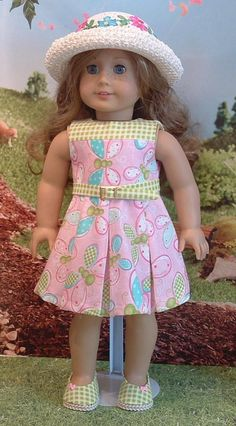 Sweet little pleated dress, matching shoes and hat for your American girl doll, or similar 18 inch dolls. The dress is made from a quilters quality cotton, and closes in the back with velcro. The listing also includes her matching shoes, and crocheted hat. Doll is not included. All my apparel is made in my smoke free home.