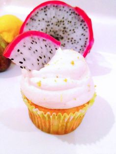 Vanilla cupcake with mascarpone dragon fruit filling topped with lemon mascarpone frosting and a slice of dragon fruit!