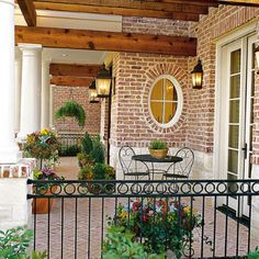 80 Breezy Porches and Patios Colorful Potted Porch - Brick Exterior - Wood Beams - Southern Living Magazine Brick Design, Patio Design, Exterior Design, Railing Design, Design Design, Outdoor Rooms, Outdoor Living, Outdoor Patios, Outdoor Kitchens