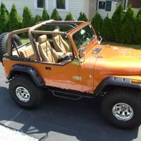 The color of my CJ is Atomic Orange pearl metallic. Its a 2007 corvette color. The guy that painted my Jeep put a ton of extra gold metallic in the clear coat.  Similar to Orange Mist or Amber Fire Pearl maybe.