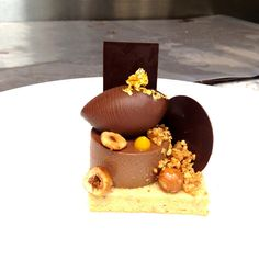 Hazalnut Dacquoise, Gianduja Ganache, Hazelnut Nougatine, Chocolate Cremoso, and Toasted Hazelnut.