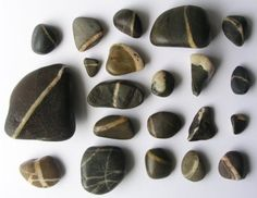 """""""wishing stones"""" found in Maine.  Use your finger to trace all the way around the white line as you make a wish."""