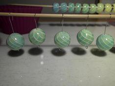 Beswirllte Perlen mit Transparent