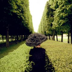Woman with Hat Between Hedges, Parc de Sceaux, France, 2004  Rodney Smith   2004  #1stDibs #MothersDay