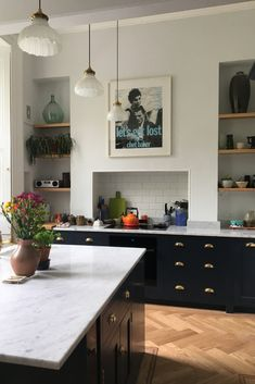 Dark blue traditional hand painted kitchen with open plan shelving, large island and brass fixings Dark Kitchen Cabinets, Kitchen Paint, Kitchen Decor, Island Kitchen, Shed Interior, Interior Design Kitchen, Eclectic Kitchen, Open Plan Kitchen, Home Kitchens