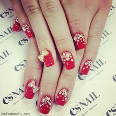 Red glitter nails with bow
