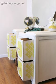 Bright white and yellow waterfall vanity makeover with English Yellow & Old White Chalk Paint® decorative paint by Annie Sloan and stenciled peekaboo drawers   By Girl In The Garage