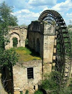 """destroyed-and-abandoned: """"An old, overgrown Albolafia Mill and water wheel in Cordoba, Spain. Photo by Chase Taylor. ethan_kahn: """"This mill is situated next to the Roman Bridge on the northern bank. Abandoned Buildings, Abandoned Mansions, Old Buildings, Abandoned Places, Beautiful Buildings, Beautiful Places, Old Barns, Haunted Places, Le Moulin"""