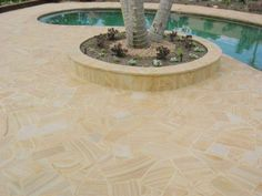 Teak Sandstone around a pool with a feature in the middle around a tree Pool Paving, Driveway Paving, Garden Paving, Garden Landscaping, Sandstone Pavers, Flagstone Pavers, Garden Landscape Design, Small Garden Design, Crazy Paving