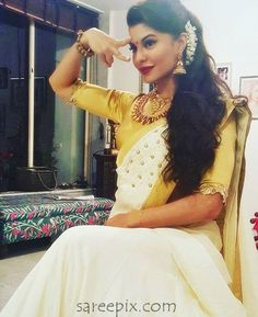 Bolly beauty Jacqueline Fernandez in Kerala traditional saree. The 30-years old actress looks gorgeous in white saree with golden half sleeves blouse. One