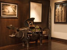 Happy Hour - This Lalanne hippo transforms into an amazing full bar, and the drinks inside change depending on the company we are having over—we always try to keep it stocked with the ingredients for our guests' favorite cocktails. [On the wall, from left to right, are works by Salvador Dalí, Hans Bellmer, Aaron Young, and Max Ernst].
