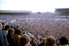 7 May 1984: Chelsea 3-1 Barnsley. CHELSEA fans celebrate promotion on the pitch after the last home game of the season...