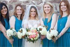 bride and bridesmaids showing off their bouquet | Ashley Gerrity Photography | John James Audubon Center Wedding