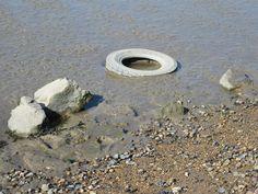 Abandoned tyre on Grays Beach, Essex 2012