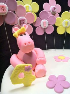 Fondant Hippo Cake Topper along with Birthday Name on Flower Petals , this is Perfect for that animal Lover or any Pink Girly Party