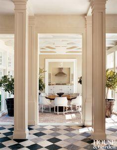 A French hexagonal table anchors the conservatory of a Hamptons retreat.  ARCHITECT: Haynes-Roberts DESIGNER: Haynes-Roberts PHOTOGRAPHER: François Halard