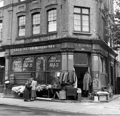 London 1950s FJ Fisher Rag And Metal Merchants On The Corner Of A Street Clothes